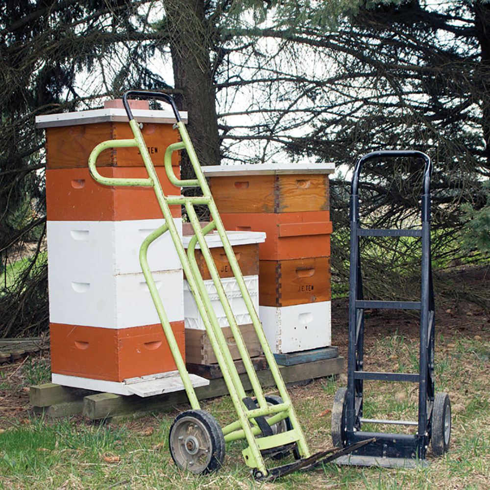 A hand truck is vital for the one-person hive move event.