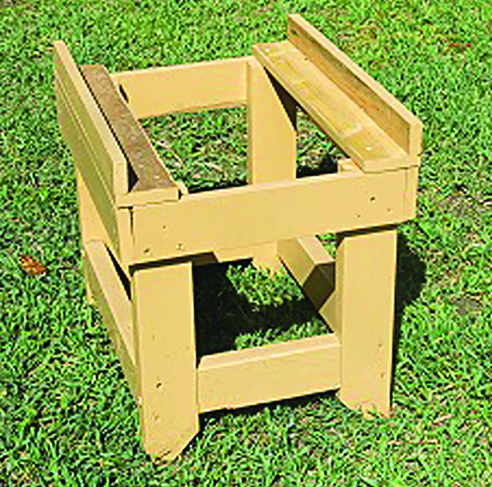 L.C.'s hive stand for an eight-frame colony.
