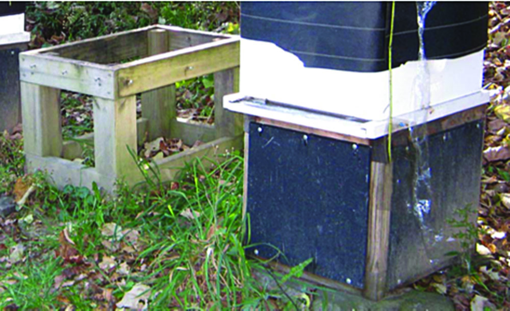 Hive stand without and with panels installed.
