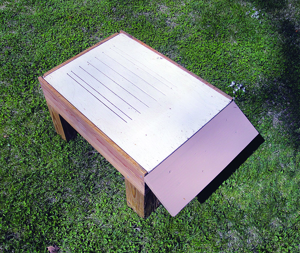 Hive stand with plywood insert in place.