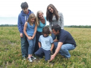 The Laing family – McKenzie, 15, wife Tracy, Aiden 11, Talus 13, Quinn 9, and father, Trevor – checkout the blueberry flowers. (Algoma Highlands photo)