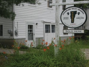 Champlain Valley Apiaries honey house and shop. The image on the sign of the state of Vermont and clover leaves has been consistently used on the CVA honey label for over 80 years.