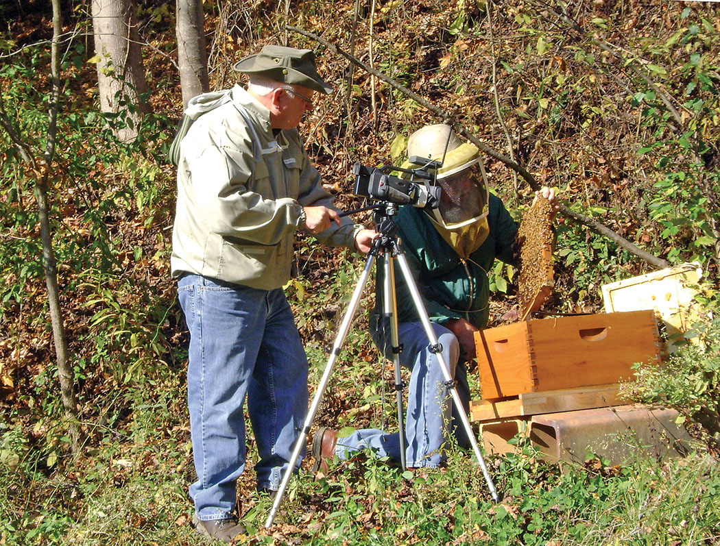 Two beekeepers and a camera.