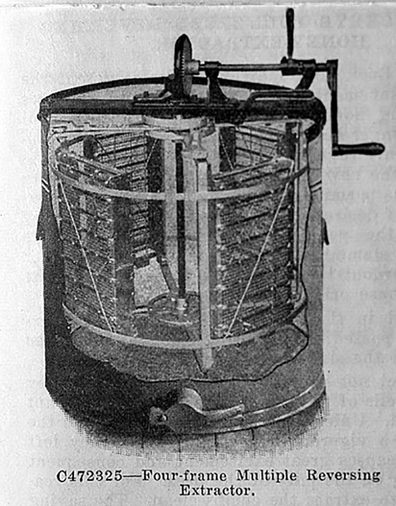 This is simply a four-frame extractor that was available in 1922. It was made from a combination of metals. The tank was galvanized with soldered seams. Of course, this is unacceptable today. It was gear driven. The gear drive could be disengaged and separate hand brake was available for stopping the spinning extractor basket. Amazingly, it was equipped with reversing baskets so frames did not need to be removed to extract opposite comb sides. Though it could be tied down. it was very nearly heavy enough just to use without tie downs.