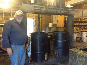 Tim Trescott and two of the hydraulic wax presses he built using old train pistons.
