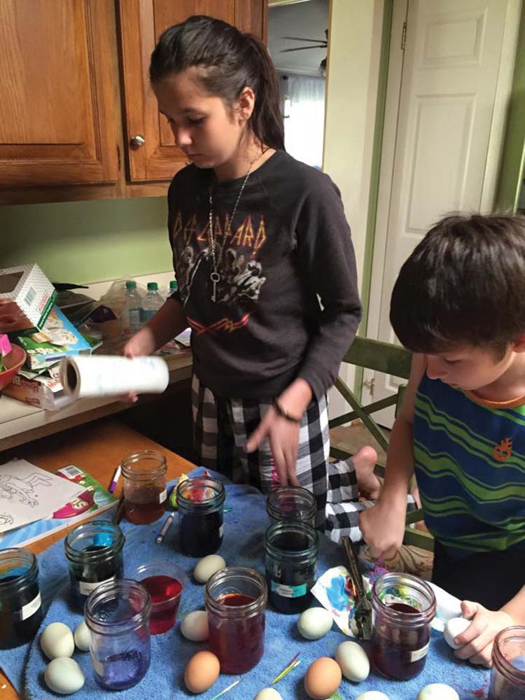 Maggie and George on egg dyeing.