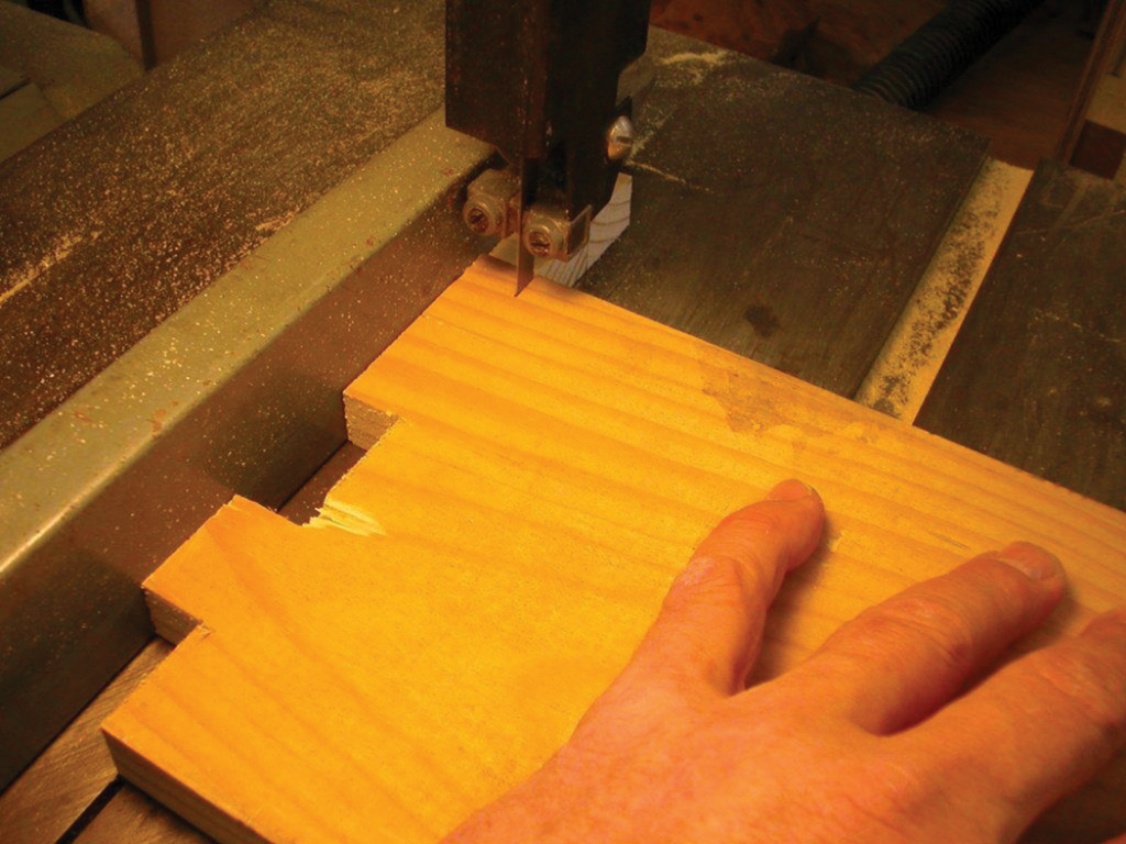 "With the band saw fence set to a ¾"" cut, remove the wood to reveal the fingers."