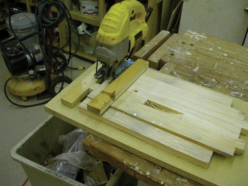Some scrap pieces are easily assembled into a hold down, guide and stop. Note the hand holds chewed out with the dado set which lead to the router and template method of cutting hand holds.