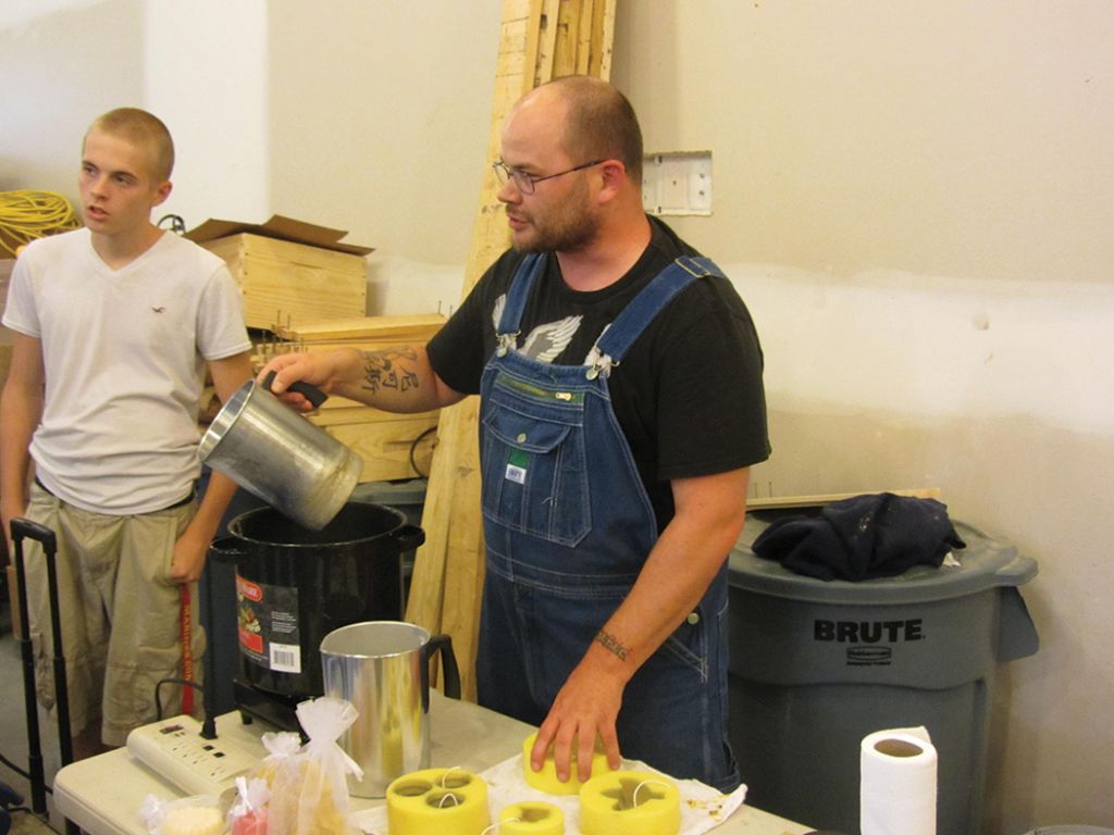 Veteran Nick and son demonstrating candle making during one of the Geezers Ridge Farm training sessions.