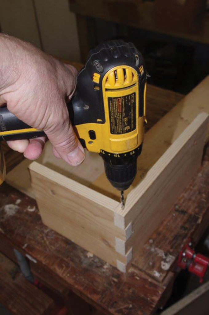 Clamp a piece in place and slide in its mate. Drill a pilot hole for the nail.