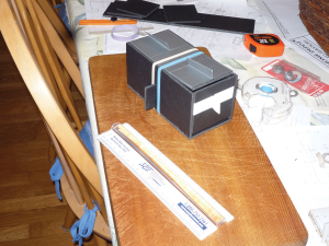 Figure 1. Beelining box made with foam core board, Plexiglas, and duct tape. The foam core board pieces are glued together. The Plexiglas top and its hinged covers are fastened with rubber bands. Hinges are duct tape.