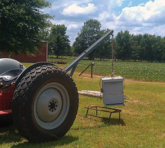 Hydraulic lift being used to pick up a hive. (photo credit – Red Belly Farm, Mississippi)