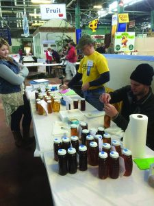 Color grading extracted honey exhibits. L-R Jessica Aurand, Steve Finke, Tom Butzler.