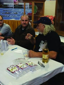 Mead judges – l) Jamie Williams of Wilcox Wineries and Bob Mazza of Mazza Wineries discuss qualities of this dry mead.