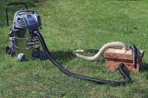 Shop vac modified to provide vacuum to the trap box.