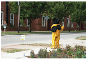 Buzzy Bee waving to folks at Pollinator Day.(photo by Loucinda Main)