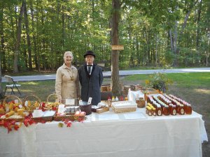 Buzz and Nancy in period costume at their stand.