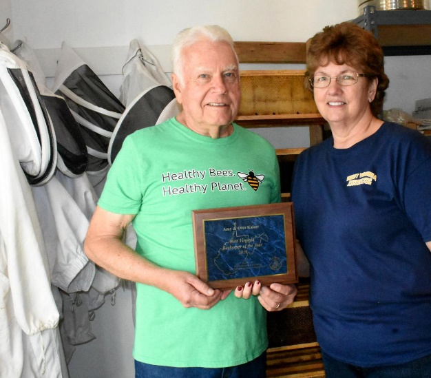 CATCH THE BUZZ – Couple Wins Beekeeper of the Year!